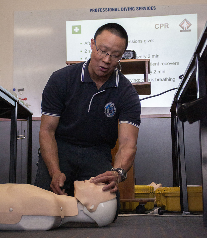 Johnny Lau CPR demonstration on dummy