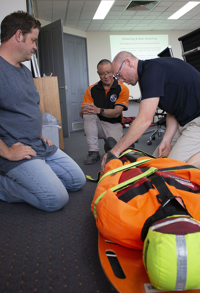 Handling a casualty with suspected spinal injury